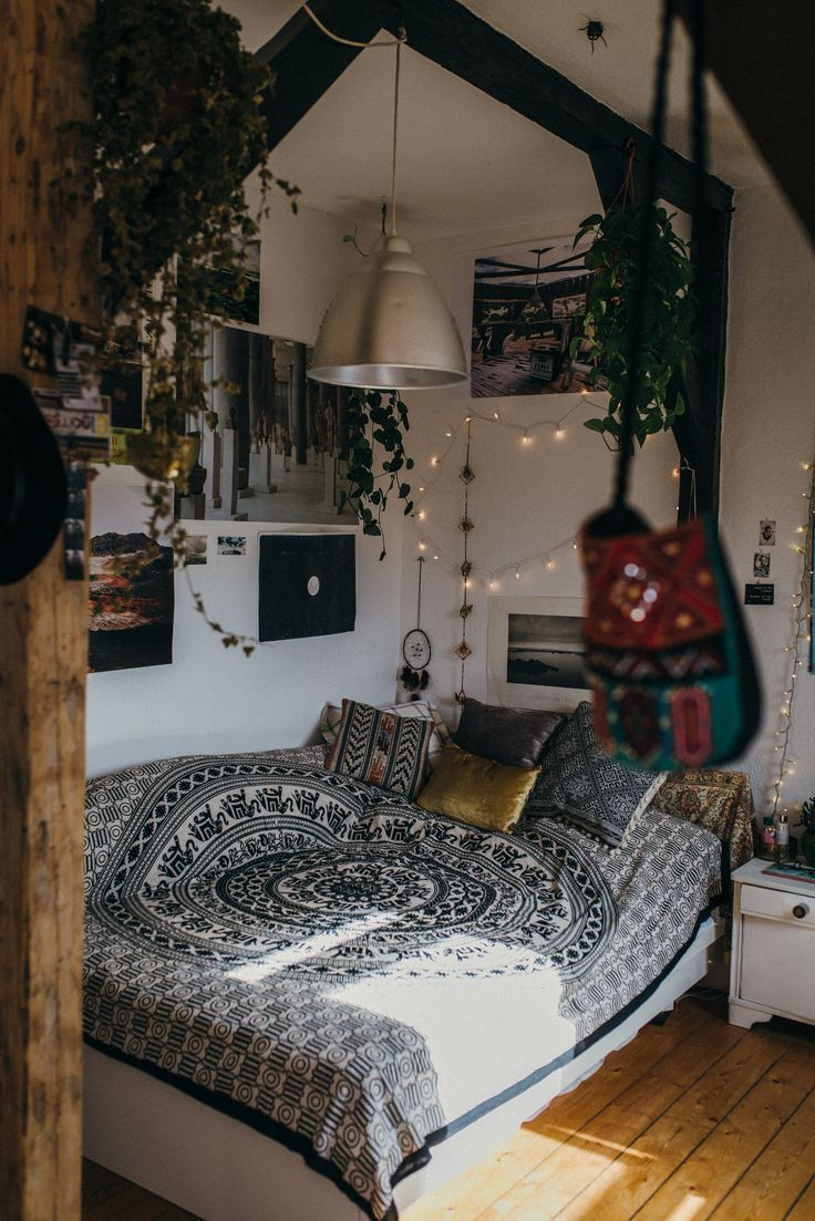 Boho Bedroom With Hanging Plants And Mixed Textiles