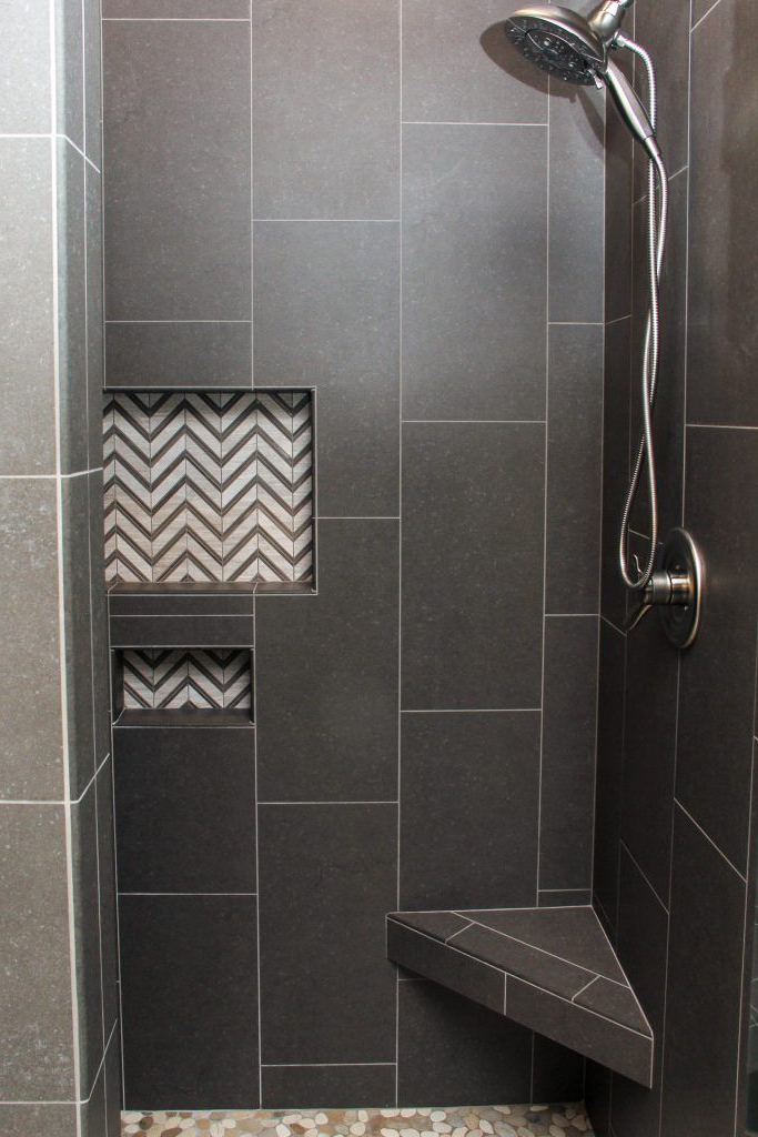 Dark Gray Tiled Shower With White And Gray Chevron Tile