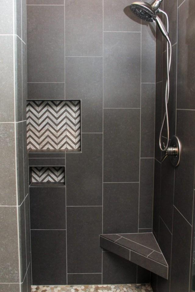 Dark Gray Tiled Shower With White And Gray Chevron Tile