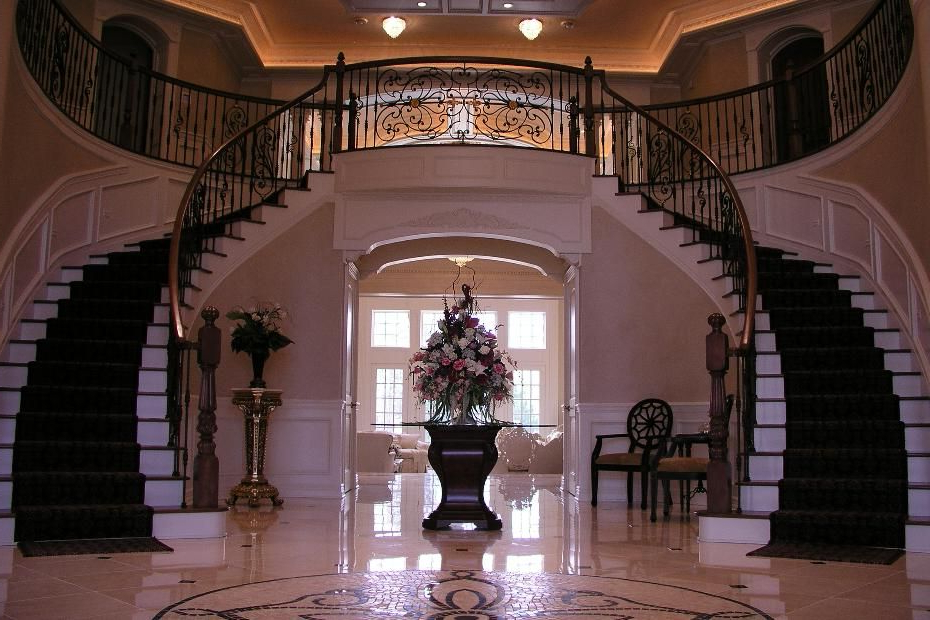 Entryway To A Luxury Home With Grand Staircase And Unique
