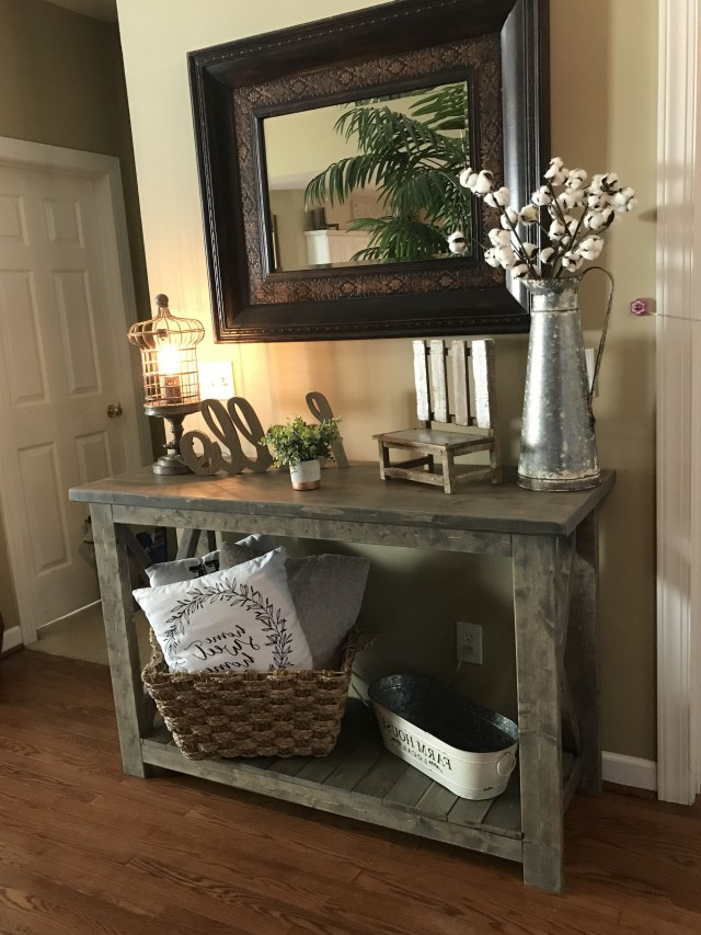 Sofa Table Silver Pitcher With Stems On Bottom Left Shelf