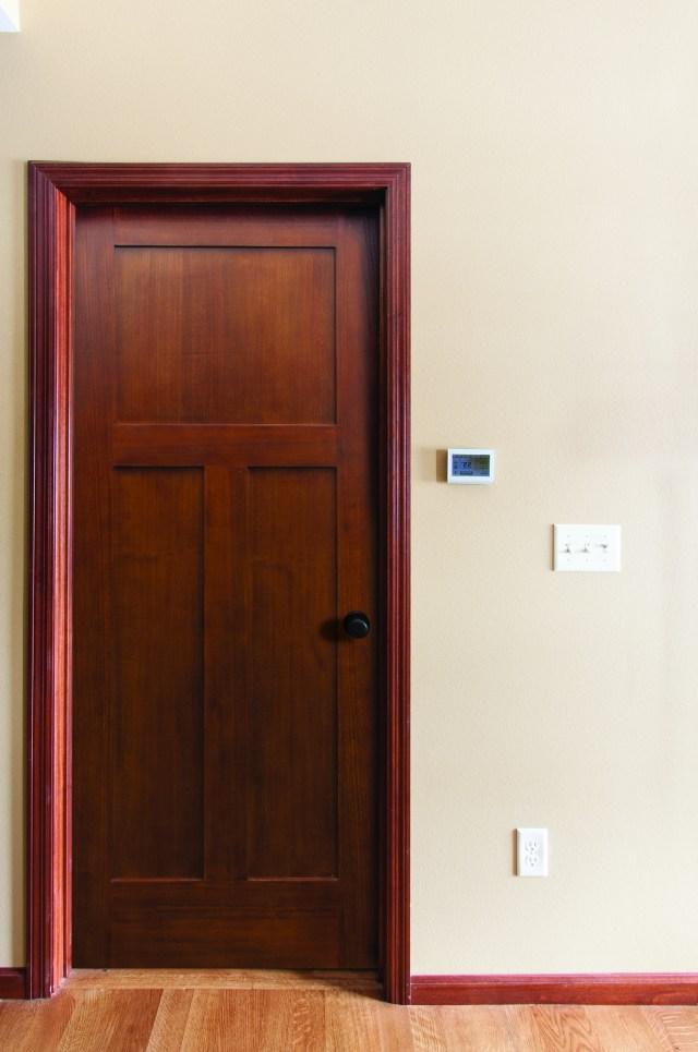 The Poplar 3 Panel Mission Door Prefinished In Gunstock