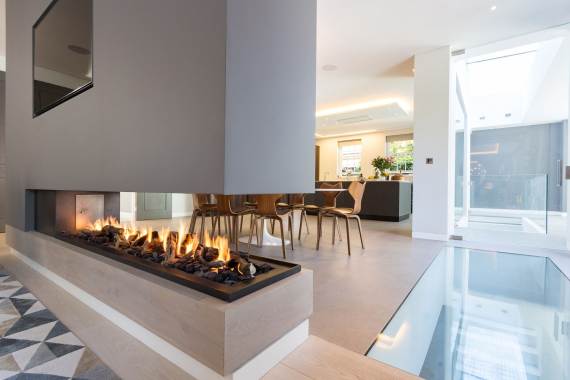This Stunning Three Sided Gas Fireplace Forms Part Of A