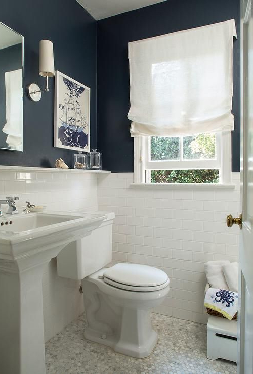 White Subway Tiles With White Grout And Navy Walls Create