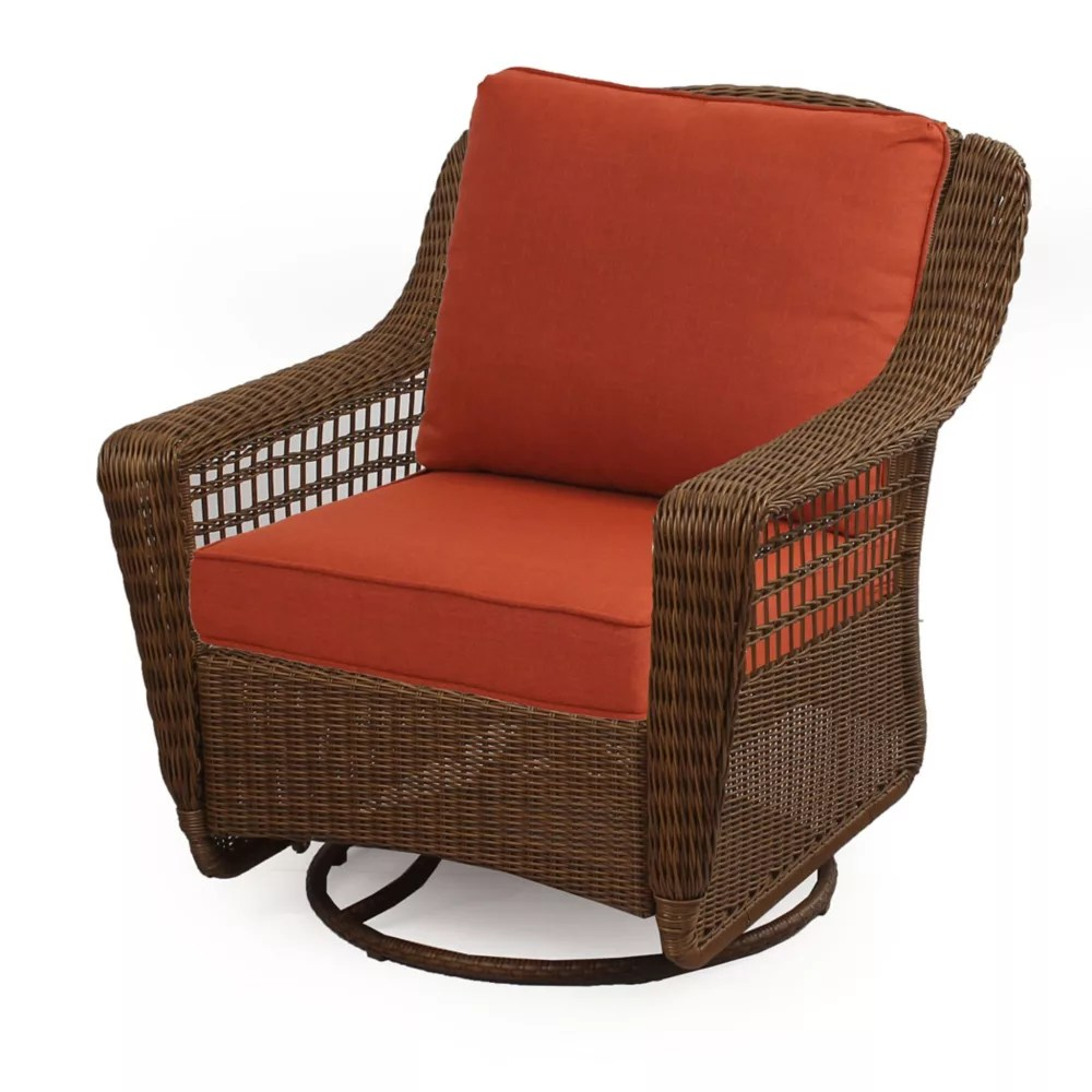 spring haven brown all weather wicker outdoor patio swivel rocking chair with orange cushions