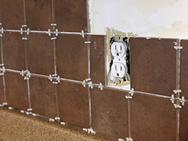 can you tile over drywall is it safe