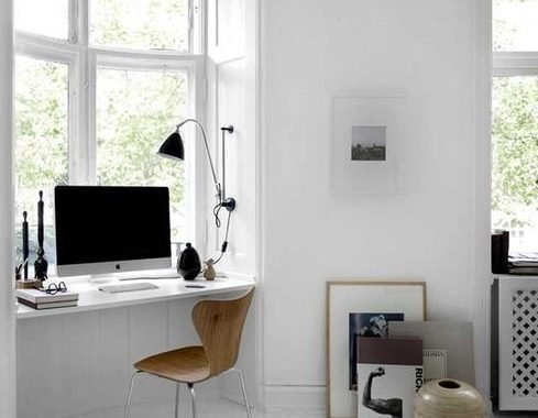 A Minimal White Workspace With A Windowsill Desk, A Wooden Chair, Some Dramatic Touches Of Black And Art