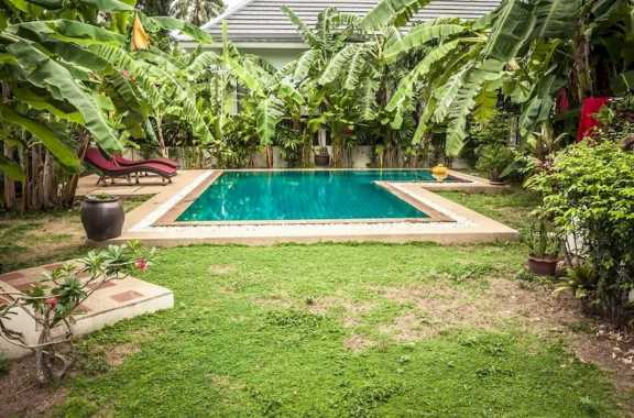 L Shaped Outdoor Pool Surrounded By Banana Trees