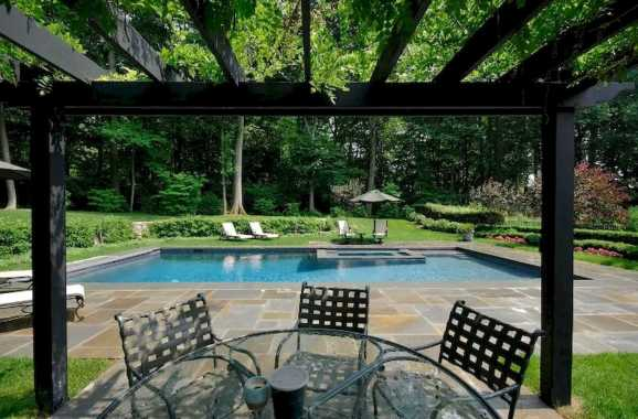 Large Treed Backyard With Rectangle Pool Surrounded By A Fabulous Multi Colored Patio