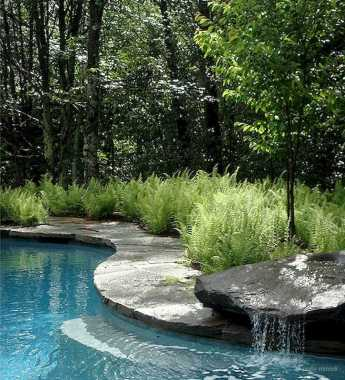 A Beautiful Waterfall By The Pool
