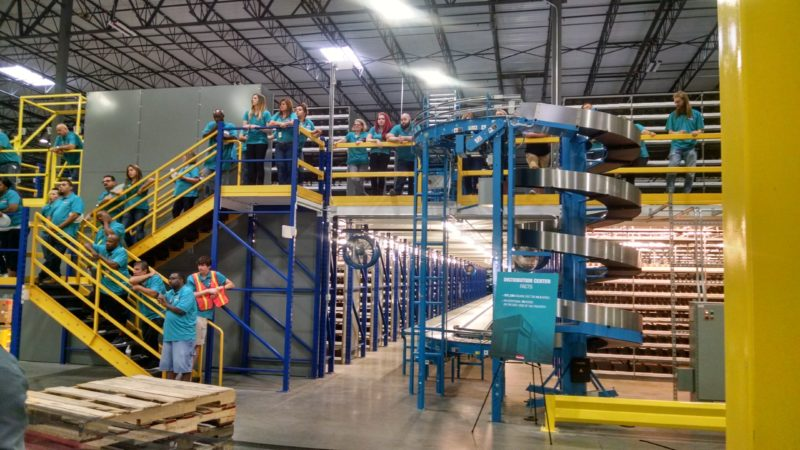 employees on stairs and packing area mezzanine
