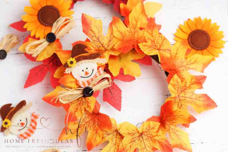 scarecrow wreath with leaves