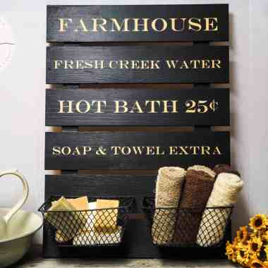 farmhouse wood sign in a bathroom