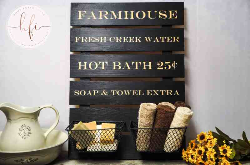 farmhouse wood sign in a bathroom