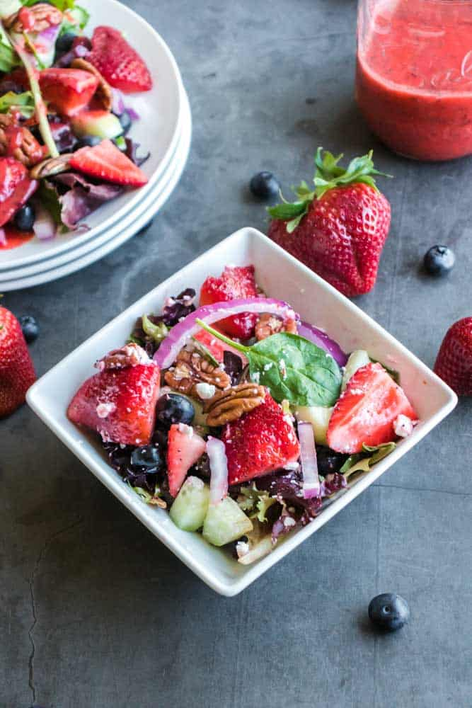 Refreshing Strawberry Salad With Poppy Seed Dressing Recipe - Try this Refreshing Strawberry Salad With Homemade Strawberry Poppy Seed Dressing and you'll be hooked. The flavors are incredible and it's super easy.  #strawberry #spinach #easy #poppyseed  #dressing #summer #salad #homefreshideas