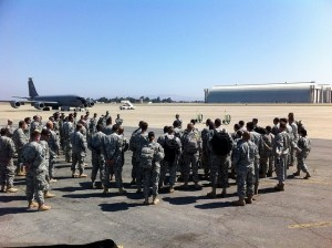 223rd Military Intelligence battalion soldiers receive a pre-flight brief on the flight line at Moffett Federal Airfield before boarding their flight to Utah for Panther Strike 2014. Members of the California National Guard unit are preparing for deployment to West Africa for Operation United Assistance (OUA) to assist with the Ebola epidemic (photo by 1st Lt. Jan M Bender/released  on FLICKR)