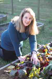 writer Jeanne Grunert in her raised bed vegetable garden
