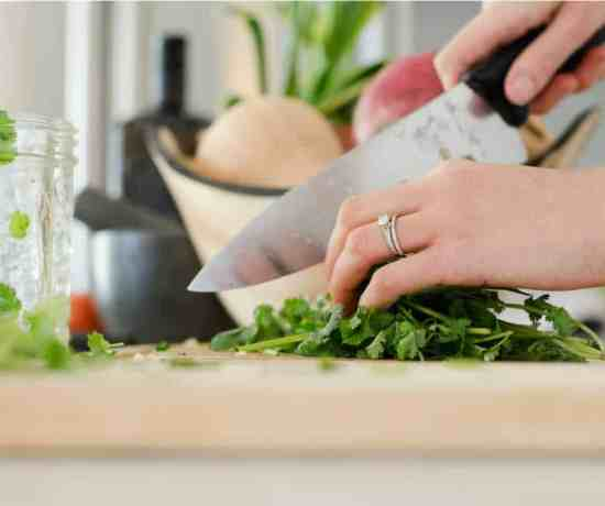a woman chopping fines herbes