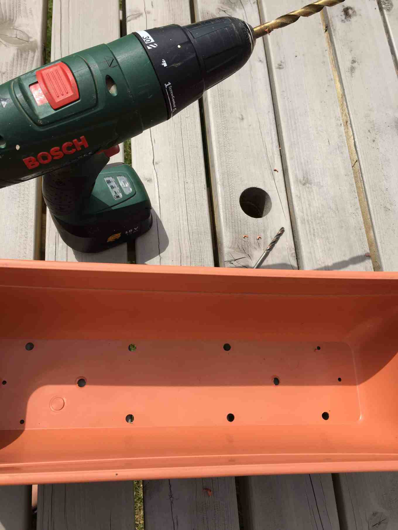 planter with drill and holes added