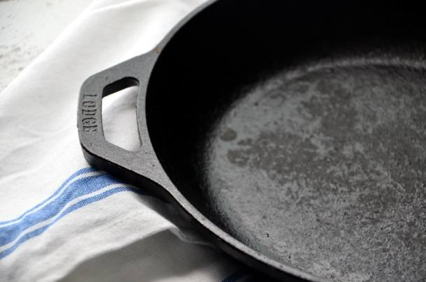 Lodge Cast Iron Skillet on a white and blue dish towel