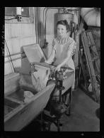 Mrs. Babcock doing the family washing with an electric washing machine and a wringer