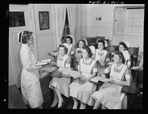Shirley Babcock at right in the front listening to a lecture with other student nurses
