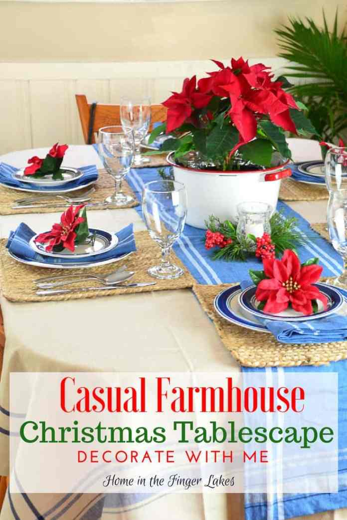 Blue-banded bistro plates, red poinsettias, French Strip table linens come together for a Casual Farmhouse Christmas Tablescape.