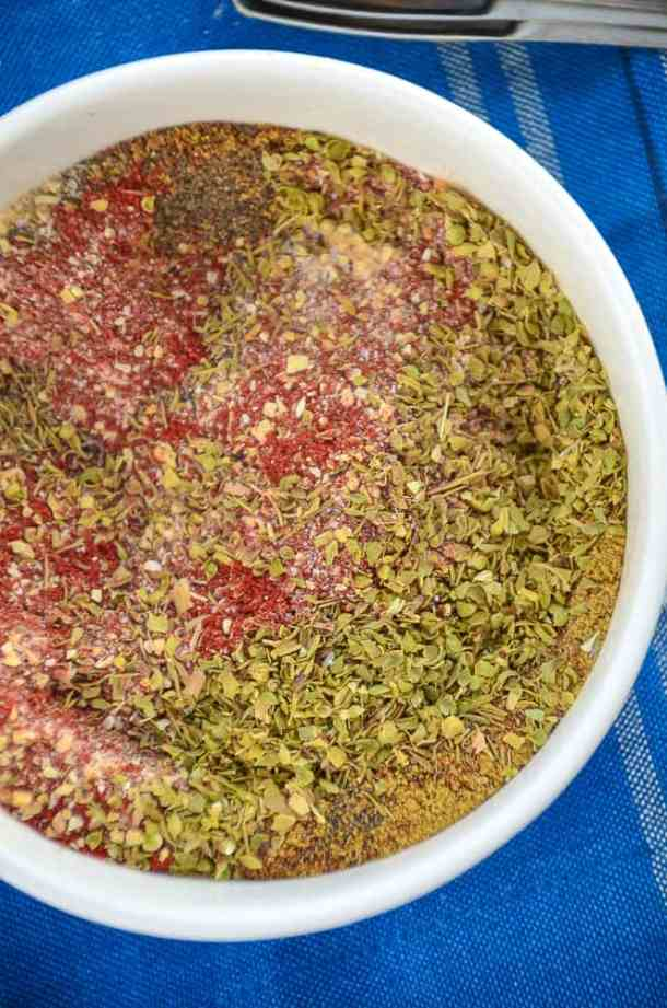 Bowl of Creole Seasoning blend on a blue tablecloth
