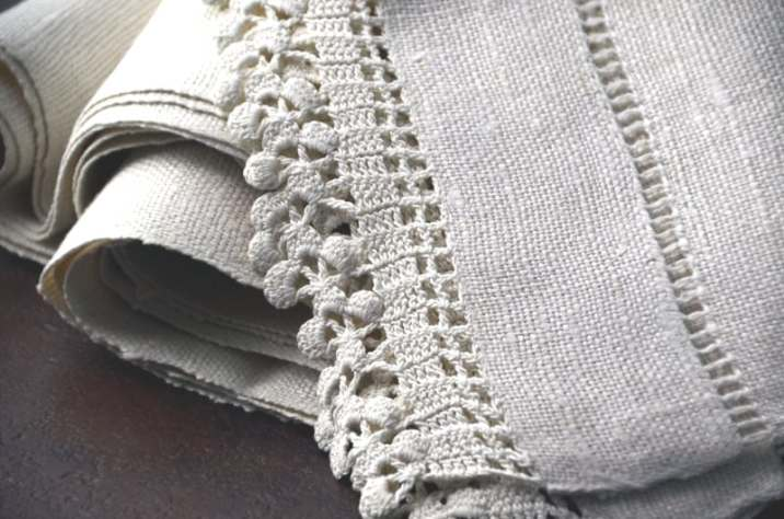close up view of elaborate stitching on Vintage linen tablerunners
