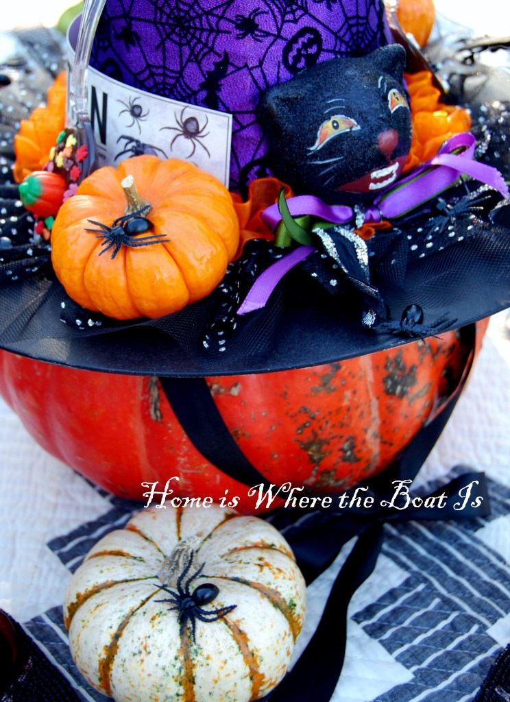 Witch hat on pumpkin table centerpiece for Halloween | | ©homeiswheretheboatis.net #Halloween #tablescapes