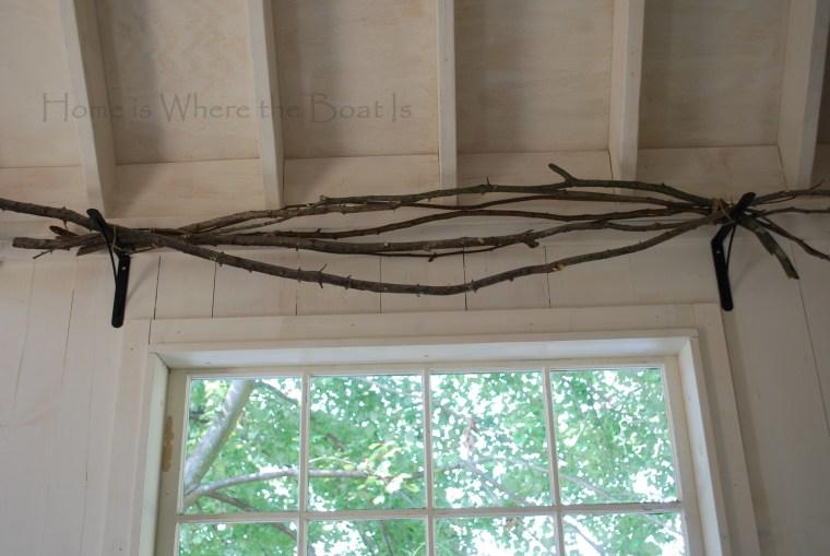 Window dressing for the Potting Shed with landscape burlap, twig rods and bird nest | ©homeiswheretheboatis.net #pottingshed #gardenshed #windows #nest #burlap