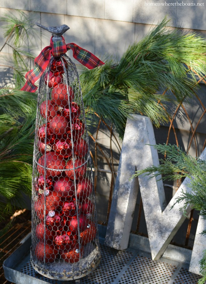 Bird topiary cone red ornaments and tartan ribbon | ©homeiswheretheboatis.net