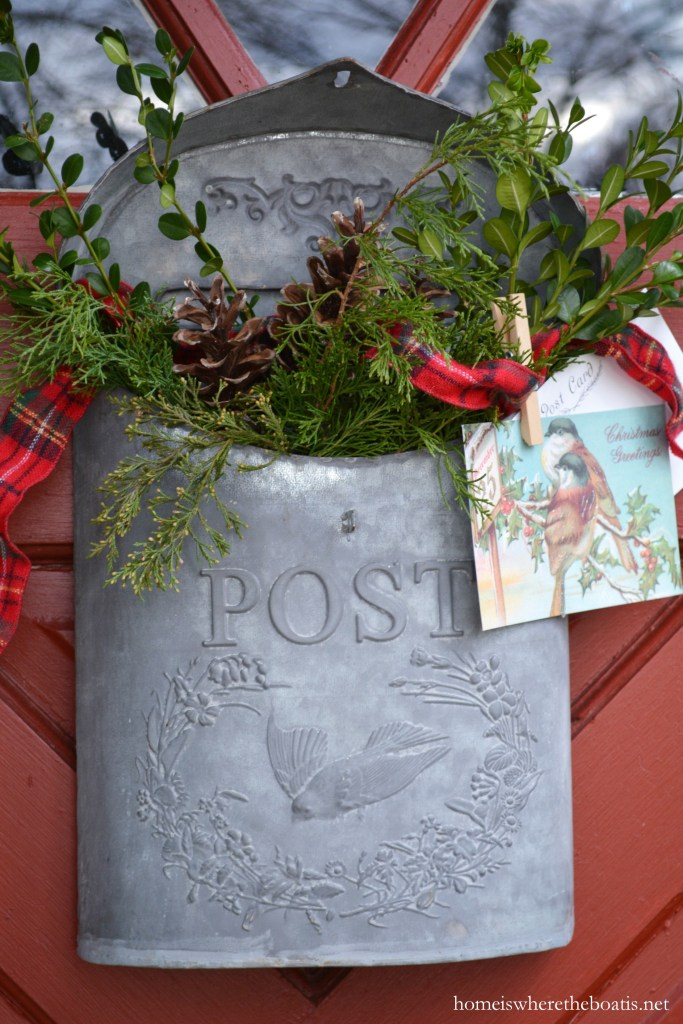 Bird post box with greenery on Potting Shed door for Christmas | ©homeiswheretheboatis.net