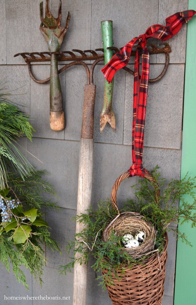 Vintage rake and garden tools with tartan ribbon hanging basket and bird nest | ©homeiswheretheboatis.net