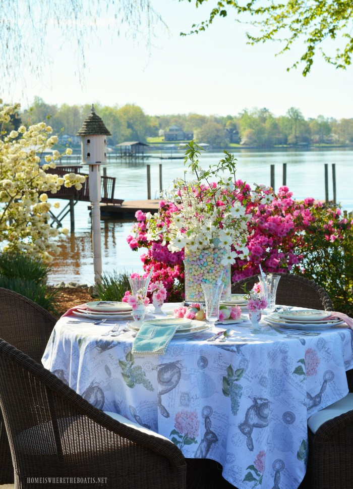 Lakeside Easter table with easy and festive centerpiece of jelly beans, dogwood and plum tree blossoms | ©homeiswheretheboatis.net #tablescapes #alfresco #easter