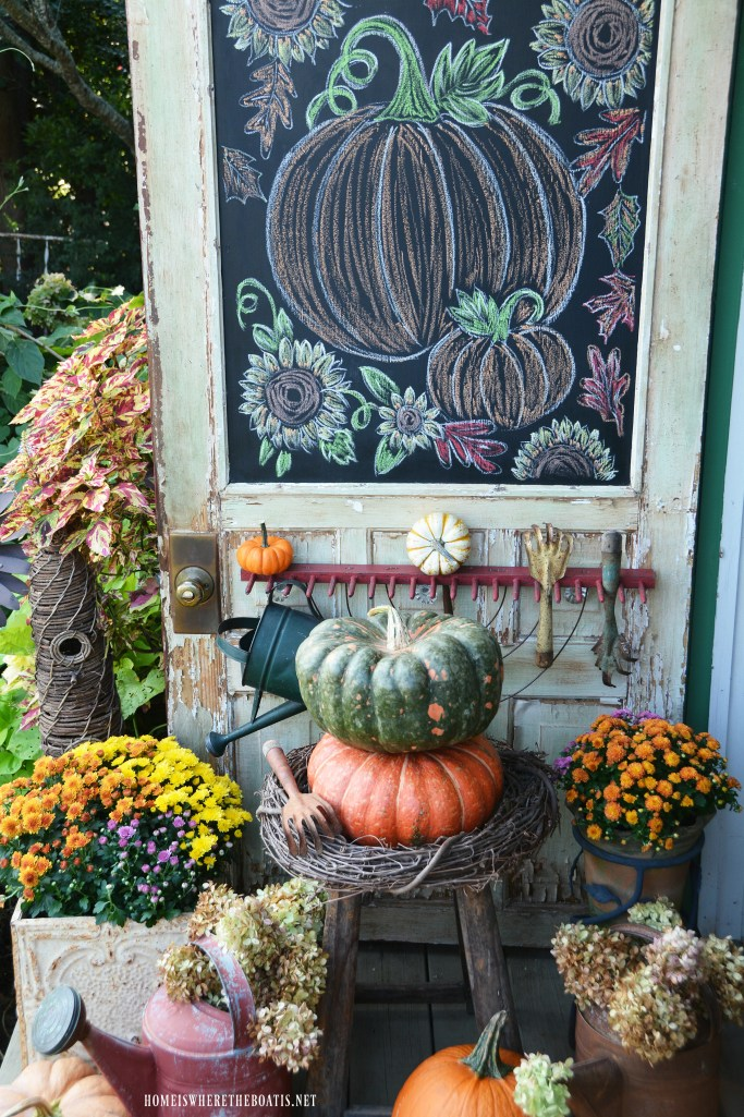 Chalking it up to Fall Chalkboard Door Potting Shed | ©homeiswheretheboatis.net #fall #shed #mums #pumpkins
