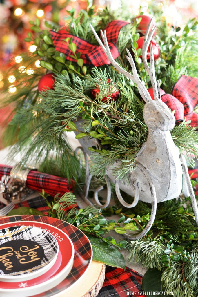 'Tis the Season: A Merry and Bright Plaid Table by the tree with Reindeer centerpiece | ©homeiswheretheboatis.net #Christmastable #plaid #tartan #reindeer