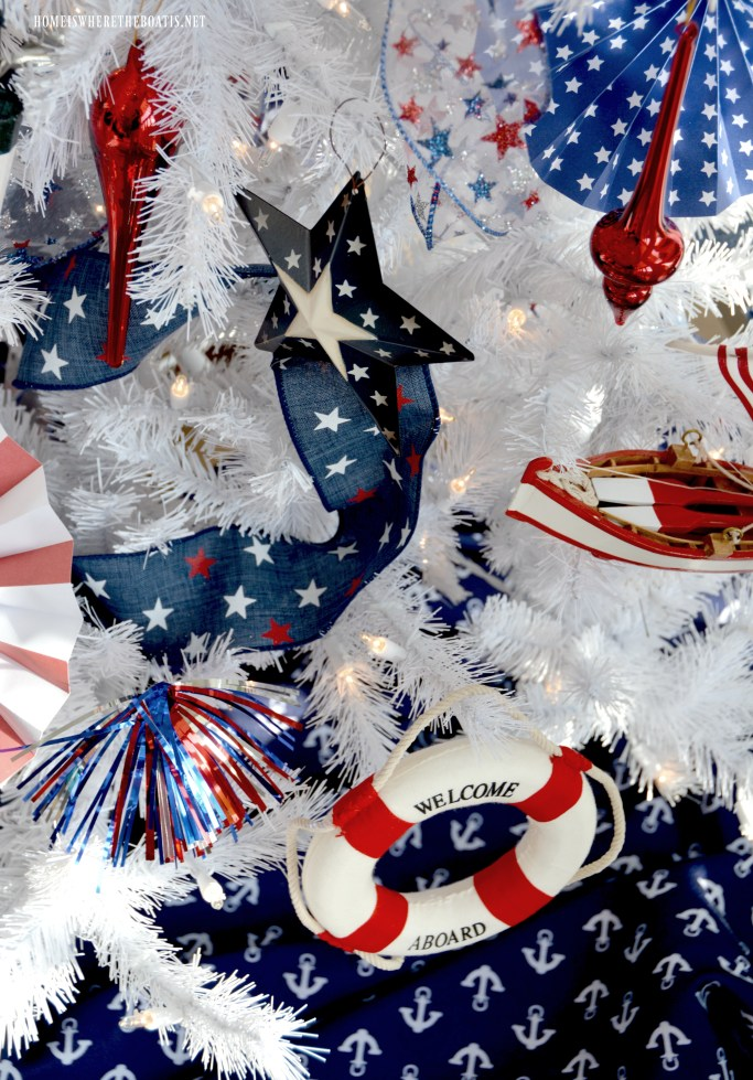 Patriotic Tree with nautical ornaments for Independence Day | ©homeiswheretheboatis.net #patriotic #tree #redwhiteandblue #porch #4thofJuly