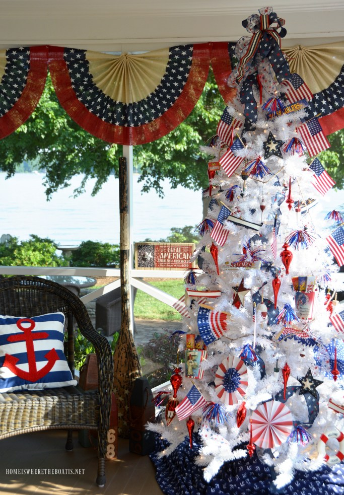 Patriotic Tree on the porch with nautical ornaments for Independence Day | ©homeiswheretheboatis.net #patriotic #tree #redwhiteandblue #porch #4thofJuly