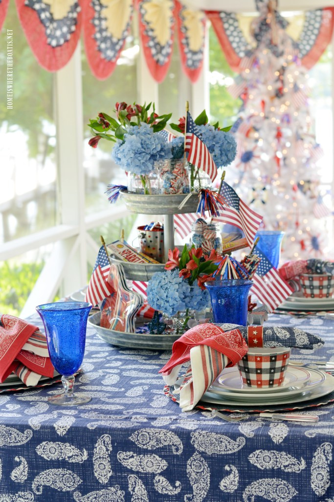 Celebrating the Red, White & Blue with a Patriotic Table and Tree on the Porch | ©homeiswheretheboatis.net #patriotic #tablesettings #4thofJuly #porch