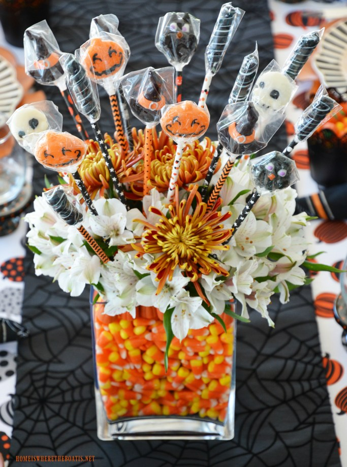DIY Halloween Candy Vase Centerpiece and Tablescape | ©homeiswheretheboatis.net #Halloween #tablesetting #candycorn #tablescape