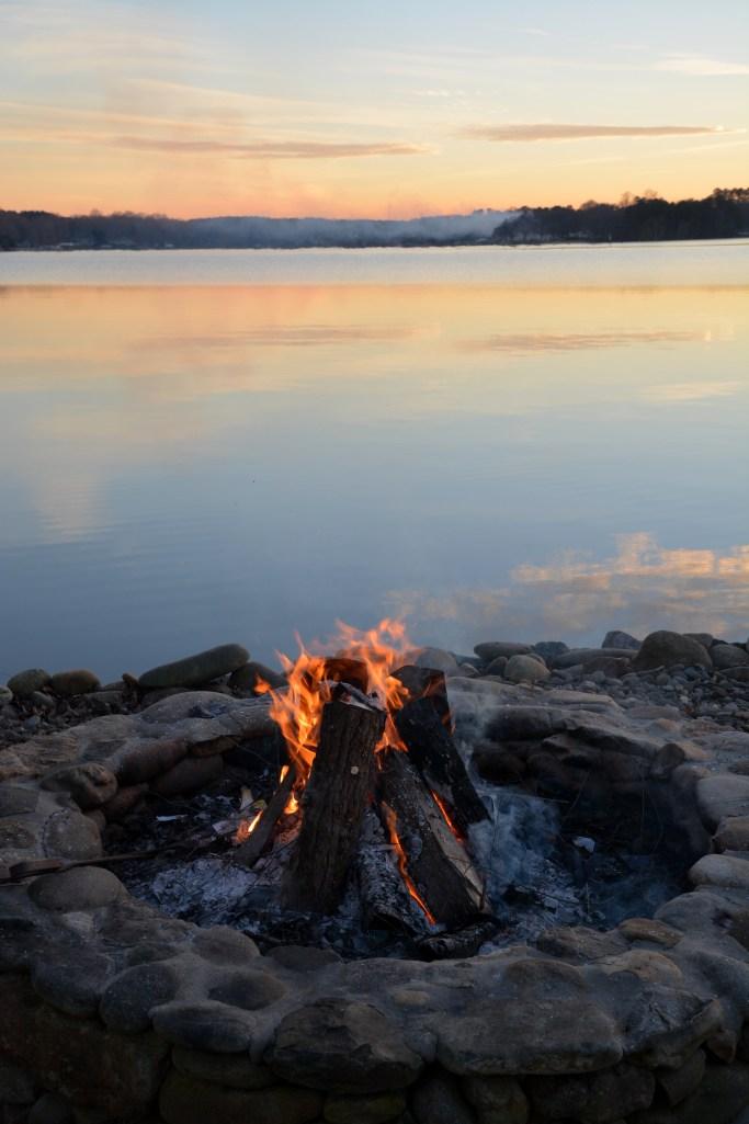 Fire pit by lake | ©homeiswheretheboatis.net #lake