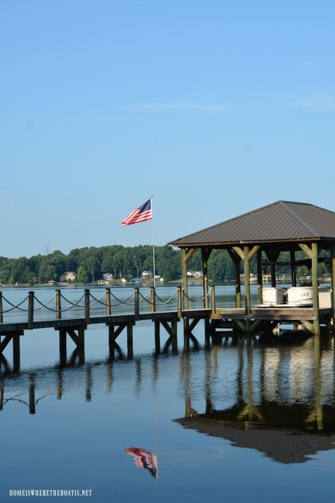 Flag on dock of lake | ©homeiswheretheboatis.net #boat #flag #lake #LKN