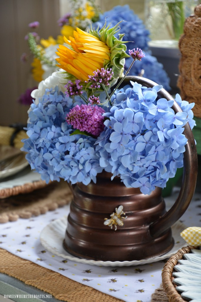 Beehive shaped watering can with flowers for National Pollinator Week | ©homeiswheretheboatis.net #bees #wateringcan #hydrangeas