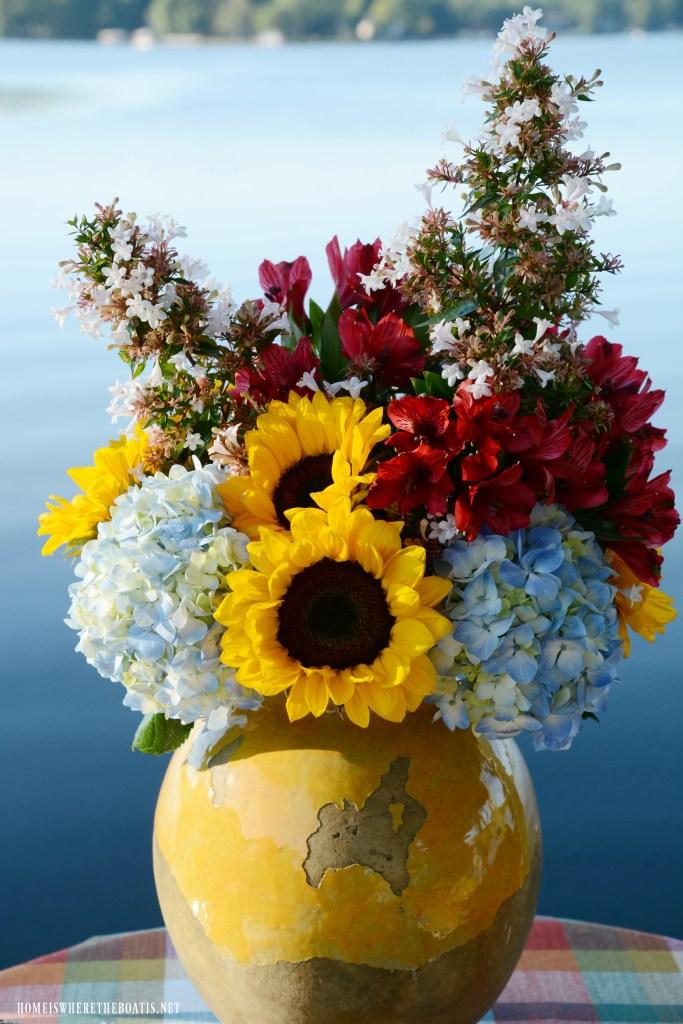 Flower arrangement with sunflowers, hydrangeas, alstroemeria | ©homeiswheretheboatis.net #sunflowers #hydrangeas