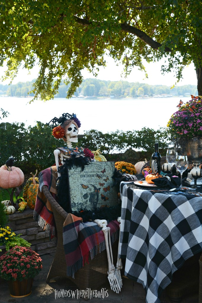 Hawthorne Gardens Wicked Beautiful Flowers Tablescape + Rib Tickling Fun | ©homeiswheretheboatis.net #halloween #tablescapes #skeleton #garden #alfresco #lake