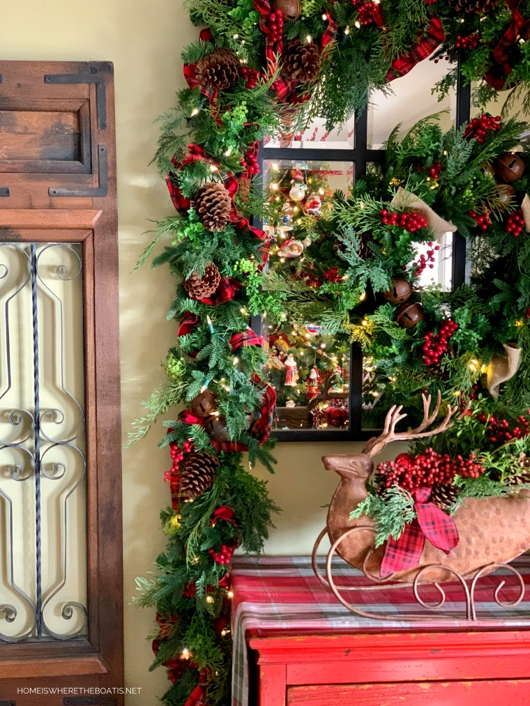 Christmas wreath and garland with berries, pine cones and tartan ribbon | ©homeiswheretheboatis.net #christmas #greenery #tartan