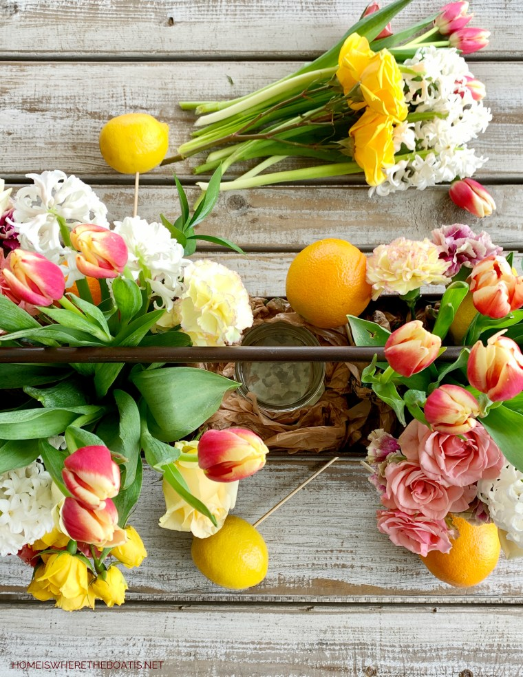 DIY Flower arrangement with mason jars | ©homeiswheretheboatis.net #flowers #centerpiece #DIY #masonjars