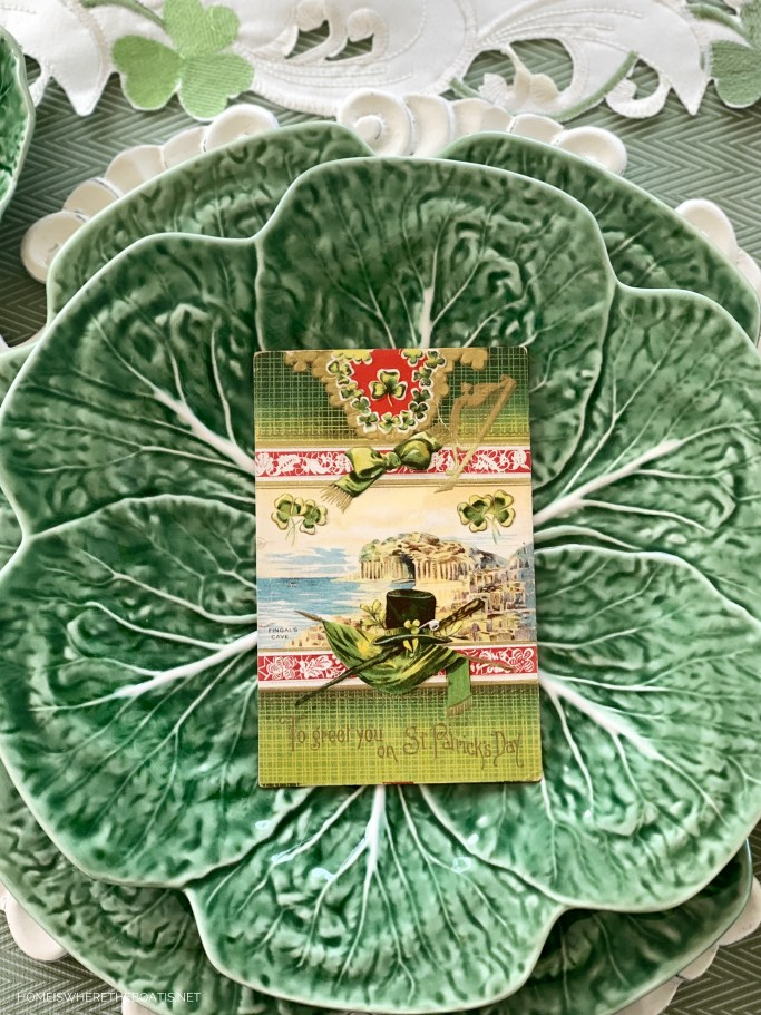 Wearing of the Green St. Patrick's Day table with vintage postcards | ©homeiswheretheboatis.net #stpatricksday #tablescapes #shamrock