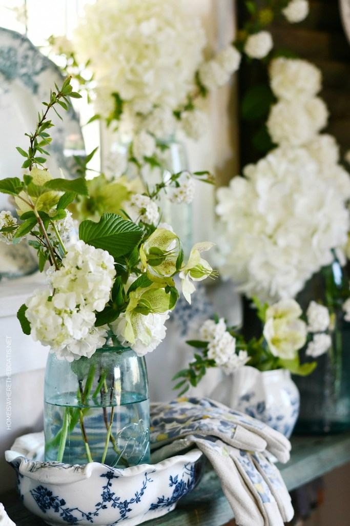 White Garden Blooms and Ball Jar Bouquets | ©homeiswheretheboatis.net #flowers #spring #masonjars